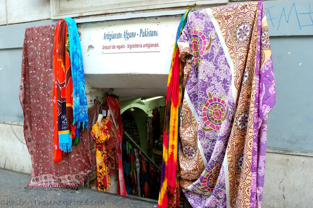 Pakistani/Afghani textile shop. The entrance is actually a trompe l'oeil, you might need to lower your head to get in, but after going down the narrow steps, the shop showcases a huge variety of fabrics, scarves, clothes, be covers and all types of textiles coming from the Subcontinent.