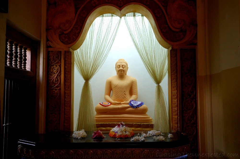 One of the statues of the Buddha in Kandy's Temple of the Tooth