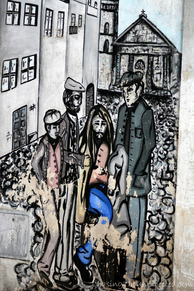 Locals in a mural on the main road.