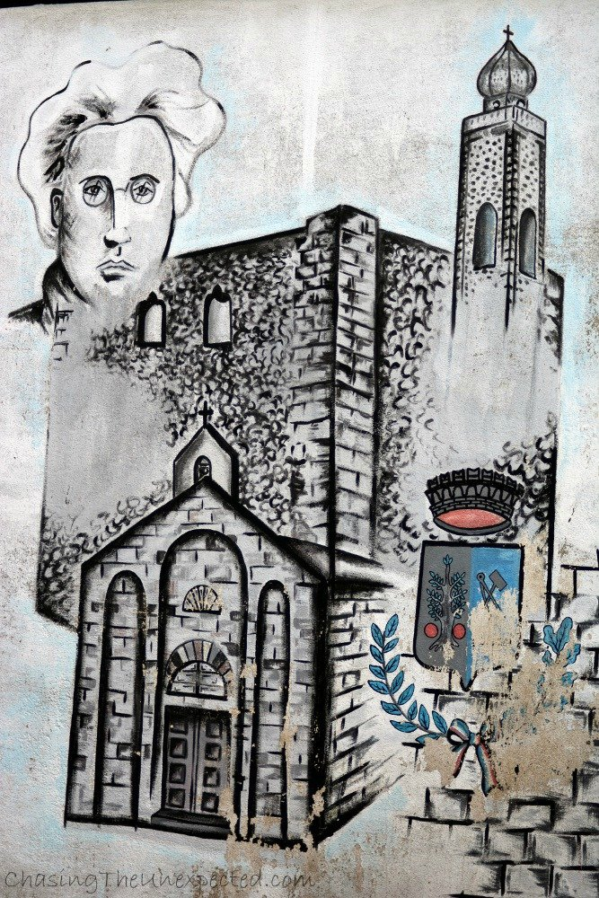 One of the murals in the main road portraying Antonio Gramsci, Italian politician, writer and founder of the Communist Party.