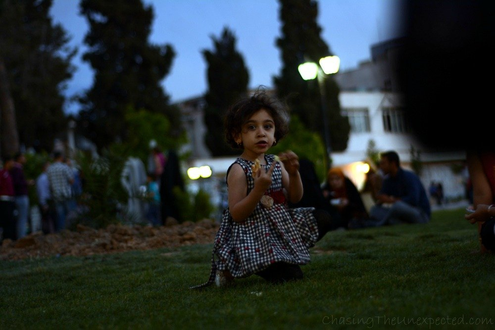 Little girl playing in the park in Shiraz