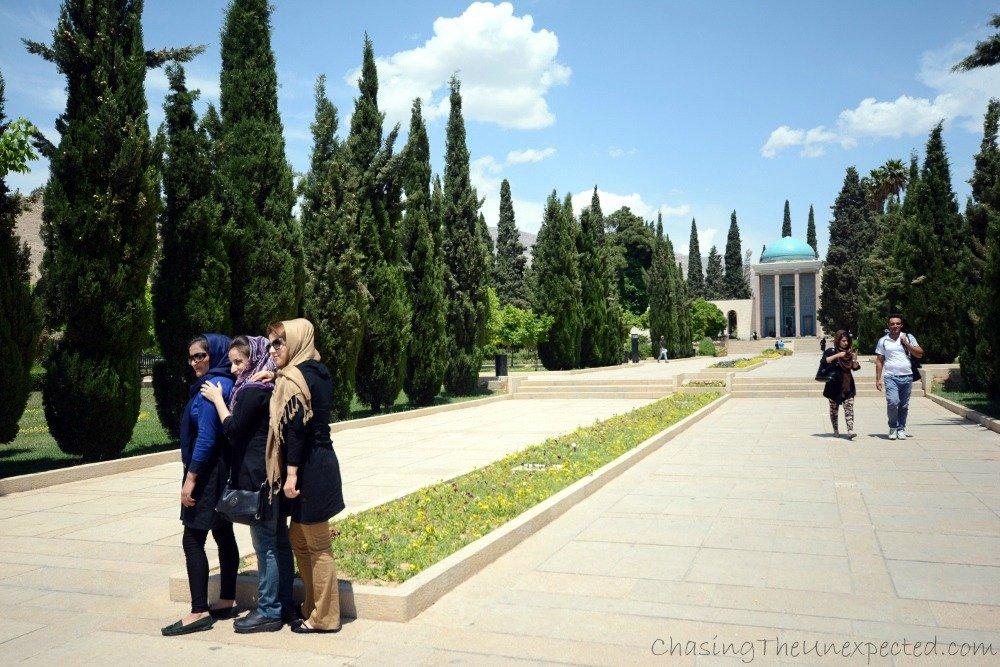 Girls posing in front of Saadi's mausoleum in Shiraz
