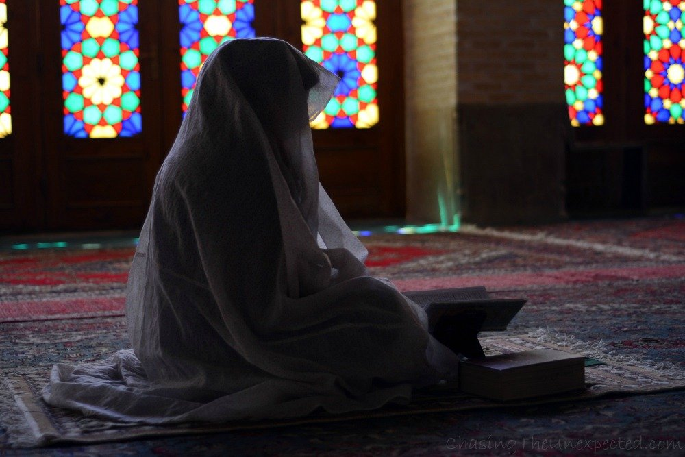 Woman praying in the Pink Mosque in Shiraz