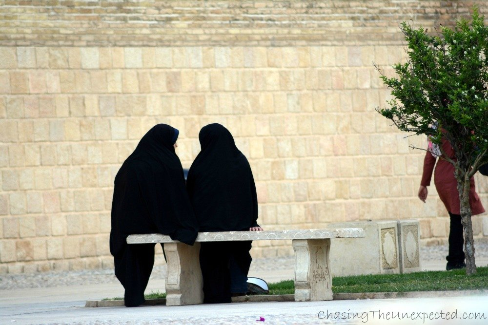 Women in chador chatting in the park