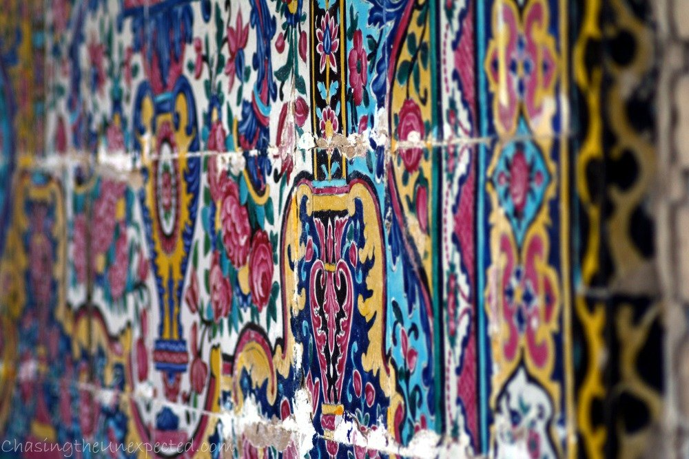 Close detail of the decoration with the typical bright colors of the Qajar art style