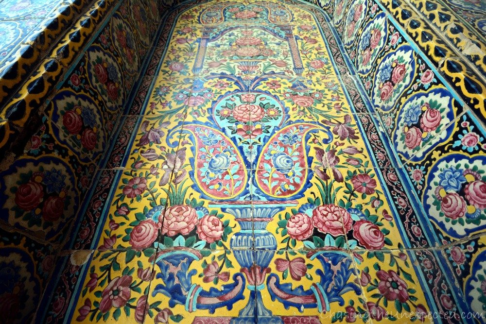 Colorful tiles decorate the outside of the mosque
