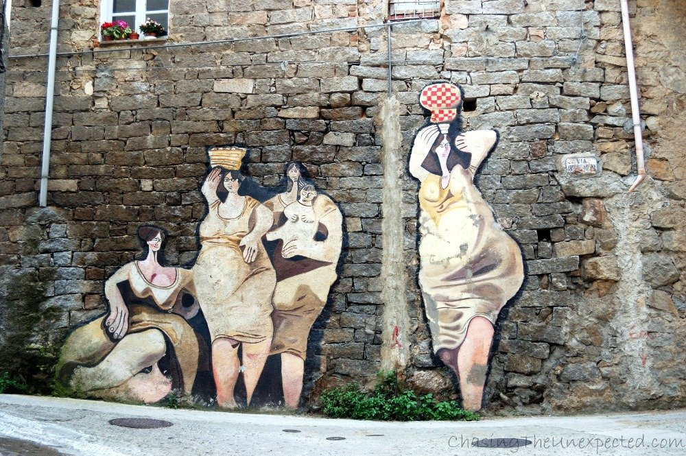 Pride and tradition in Orgosolo murals, beautiful side of the real Sardinia