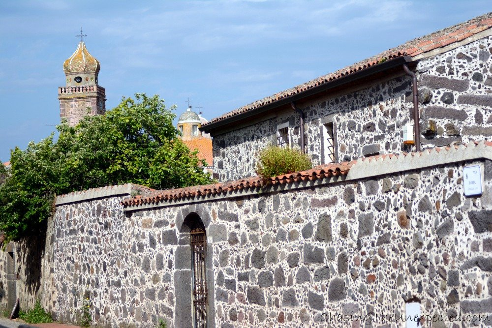 Typical stone architecture in Ghilarza, with the bell tower in the background