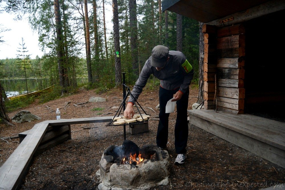 Our guide, Johannes, showing us the typical Finnish way to have a snack in the middle of the forest