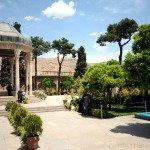 Hafez mausoleum in Shiraz surrounded by a lush vegetation