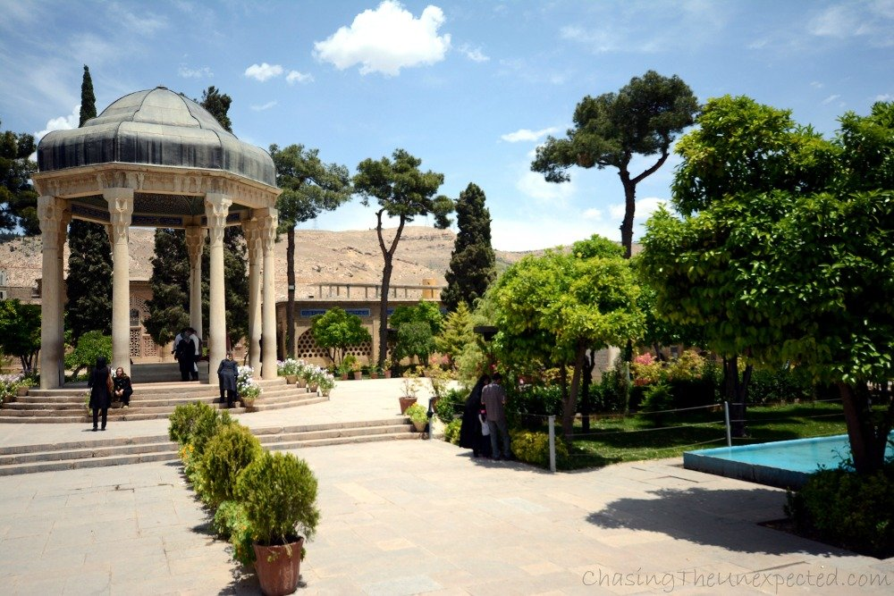 Hafez mausoleum in Shiraz surrounded by a lush vegetation