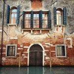 Typical Venice facade leaning on the water