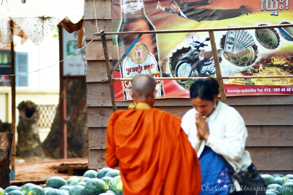Monk collecting donations from the locals