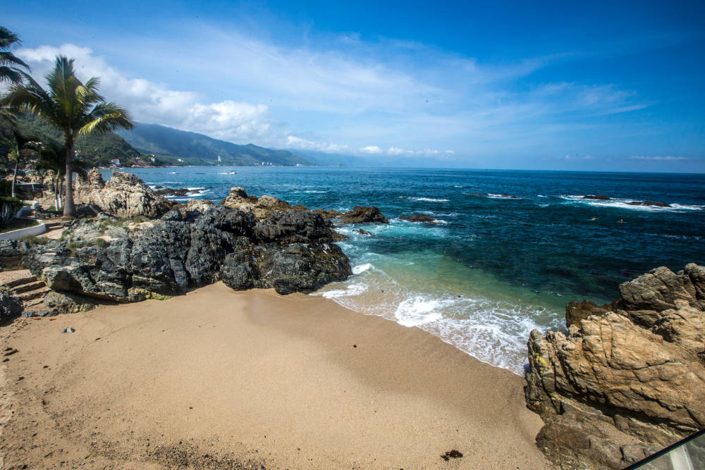 The private beach of Karma Hotel, one of the best places to stay in Puerto Vallarta.